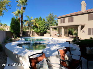 Spacious back yard with fireplace, pool, spa, mature trees, garden, RV Gate etc!
