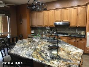 Kitchen with granite counters, huge island and bar-height seating