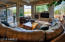 Relax or entertain in this light, bright, casual Great Room with fireplace.