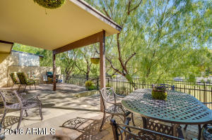Outdoor living space with covered patio and two paved patio areas to enjoy. Easy maintenance with community trees & greenbelt to enjoy.
