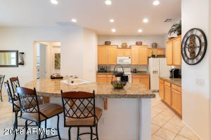 Kitchen boasts large granite island and plenty of granite counter space.