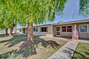 Fabulous Sun City location with large trees and cool grass