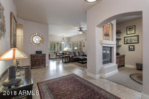 Grand foyer that opens to the living room and office give a bright and airy feel upon entering this lovely home.