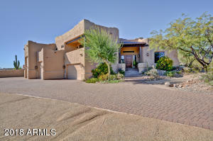 Nestled in the foothills this magnificent home features RV garage, open concept and country living close to amenities