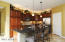 Kitchen Breakfast Bar. Walk-in Pantry plus 2nd Pantry. Over/Under Cabinet lighting