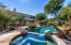Enjoy your resort style back yard! Complete with spa, pool, green space and lush surroundings.