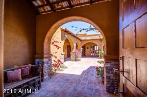 Through the door into the entrance of the courtyard, casita to the right, main entrance straight ahead.
