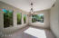 Open dining room with views into the backyard