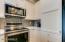 Beautiful backsplash tile & under cabinet lighting