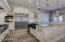 Custom designed cabinets, high end appliances and lighting fixtures add to the charm and grace of this home..