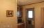 Bedroom showing storage, tv and back exit door