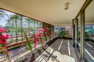 This beautiful Optima Camelview very large 2 Bedroom 2 Bath 1773 Sqft Corner Unit is available fully furnished and turn key. Boasting a significant remodel with breathtaking new wood flooring, paint, lighting, carpet in the bedrooms and a completely remodeled huge covered patio/terrace. Simply a must see in person this unit is one of the best values on the market in Optima Camelview. Optima caters to LUXURY Lifestyle Living featuring concierge, Gated parking, party room w/Caterer Kitchen, Fitness Center/Equipment, Lockers/Steam rooms.Indoor pool/spa, 2 Outdoor Pools/Spas, Racquetball/Basketball, putting gree