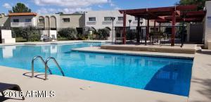 Large community pool with shade. Steps from your front door to pool. Relax in the sun or cool down in the water.