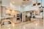 Kitchen with double oven, granite breakfast bar, Restoration Hardware Lighting