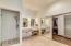 Spacious Master Bathroom with large walk-in closet, separate sinks, and separate remodeled shower/tub