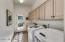 Laundry Room with Separate Entrance Outside and Cabinets for Extra Storage