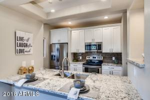 This GRANITE is Beautiful! Check out the Back Splash!
