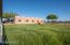 The property has two large grassy paddocks and Santa Fe style structures.