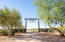 The vacant 7+ acres fronting Rio Verde Drive provide land to build further equestrian facilities or your dream ranch home.