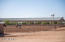 The efficient and charming ranch has a great producing well, grassy paddocks, covered riding lighted arena (125'x250'), an outdoor riding arena (150'x300'), 85+stalls and accommodations for ranch staff.