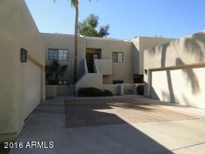 Super nice updated Courts II unit with kitchen open to living room for a nice ''arrival'' and open feeling. Wood floors, updated baths & kitchen with a contemporary flair. Light and bright with patio overlooking the lake on the 12th hole of the Links course at the Arizona Biltmore Golf Club. Walk to the Arizona Biltmore Resort and enjoy a true ''resort'' style residence with one garage space and ample parking just across the street, as is the pool, spa and tennis courts! Staged for showings and furniture does not convey. Interim occupant untll Monday 11/12/18.