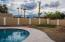 Huge backyard with pool and synthetic grass.