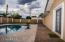 Beautifully upgraded travertine pavers surround the pool.