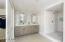 Spa-like master bathroom with walk-in closet.