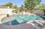 Pool surrounded by child safety fence is ready for Summer fun!