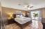 Large Master Bedroom w/external door to the beautiful pool!