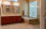 Bath has new tile floor, shower, shower doors, lights, mirrors. Tub has jets