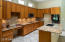 Large kitchen has oodles of cabinets