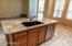 Kitchen island has KitchenAid dishwasher