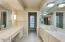 Separate vanities and shower/toilet room