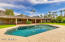 Palm trees line this beautiful acre+ lot on this private lot