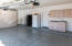 3-car garage with sink & cabinets as well as extra storage cabinets