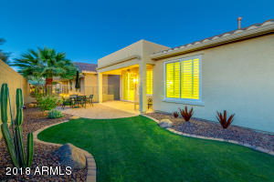 Completely fenced, private backyard with artificial turf