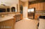 kitchen with breakfast bar and pantry