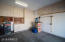 garage with built in cabinets