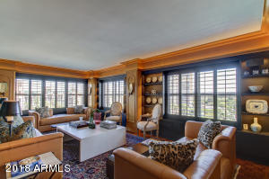Living room with two exposures and architecturally lit hardwood paneling