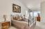 Large master bedroom with exit to your private hillside backyard.