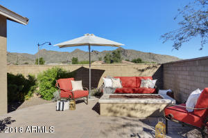 Raised, second rear patio offers a gas firepit and exceptional mountain views, yet the block walls also provide privacy.
