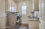 Large laundry room provides direct access to master closet, plus provides ample storage and a sink.