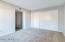 Master Bedroom w/ wall to wall closet.