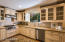 Kitchen features granite counters