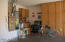 The extended garage features built-in cabinets, water softener, and a workbench.