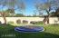 Trampoline and grass play area