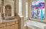 Jacuzzi tub, stain glass, beautiful tile, walk-in shower.
