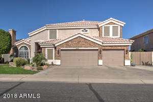 Beautiful Stone front, professionally landscaped, 3 car garage & RV Gate!