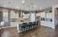 Large kitchen island a lovely place for friends and family to gather and entertain.